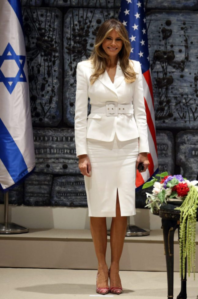 First Lady Melania Trump smiles as she stands next to US President Donald Trump