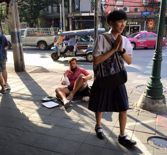 Foreigner begging on the street in Thailand